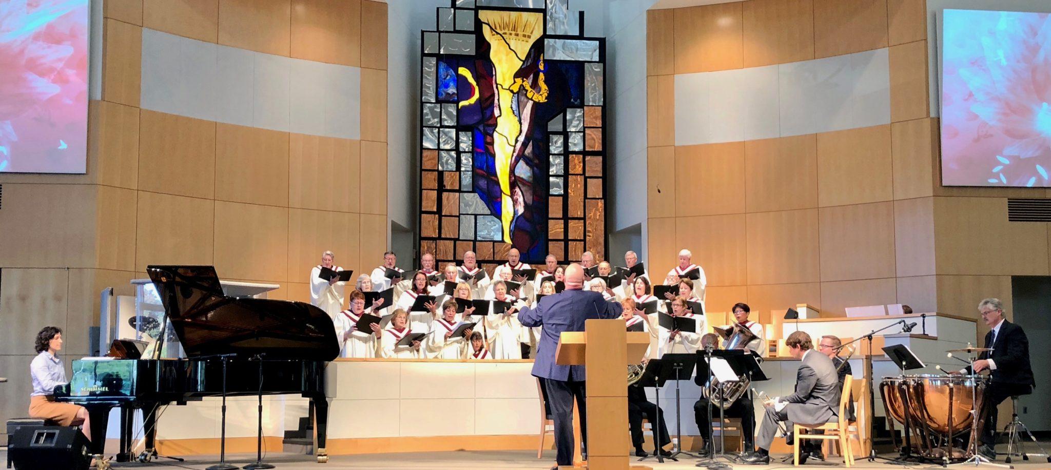 Brian Piper directing the choir